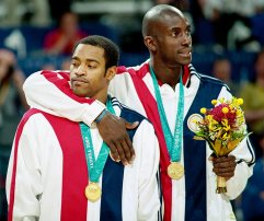 Winning Gold for Team USA at the 2000 Sydney Olympics. Pictured with teammate Vince Carter