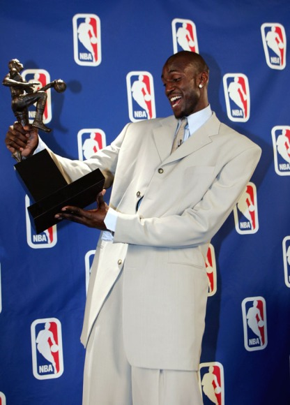 Receiving the MVP trophy after a stellar 2003-04 season where he averaged 24.2 pts, 13.9 rebs, 5 asts, 2.2 blks & 1.5 stls. (Photo by Jesse D. Garrabrant/NBAE via Getty Images)